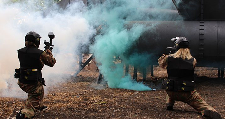 Different coloured smoke grenades merging to provide temporary cover.