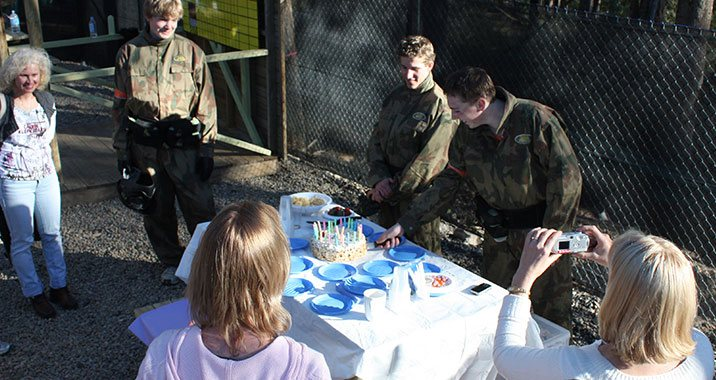paintballing group: kids birthday celebration at paintball game zones.