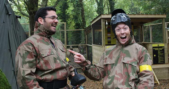 Couple Enjoy Paintball Day Out Game